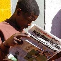 African man reading